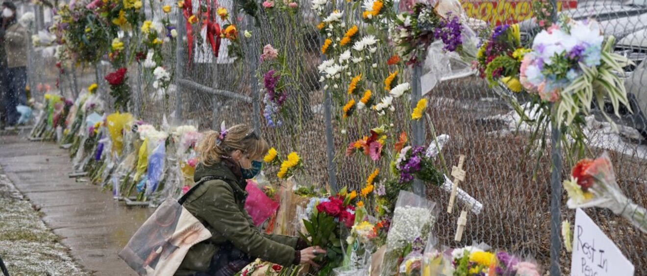 Mourners leave flowers at the site of domestic terrorism attack at a supermarket in Boulder, Colorado.