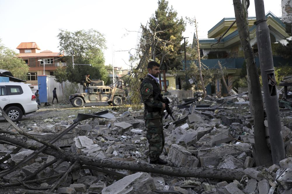 An Afghan security person stands amid debris from a damaged building following an attack that apparently targeted the country s acting defense minister - Blog